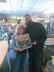 """Price Jones, right,  poses with the first """"Grown Folk"""" coloring book going to his very first Kickstarter backer."""