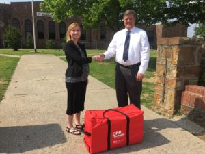 Stevie Basham, left, Webco Industries Product Specialist and Wellness Coordinator presents the CPR kit to Joe Pierce, Kellyville Public Schools Superintendent.